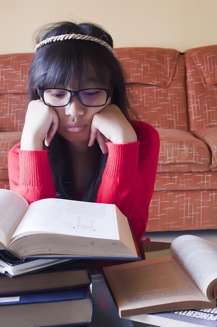Girl reading massive book