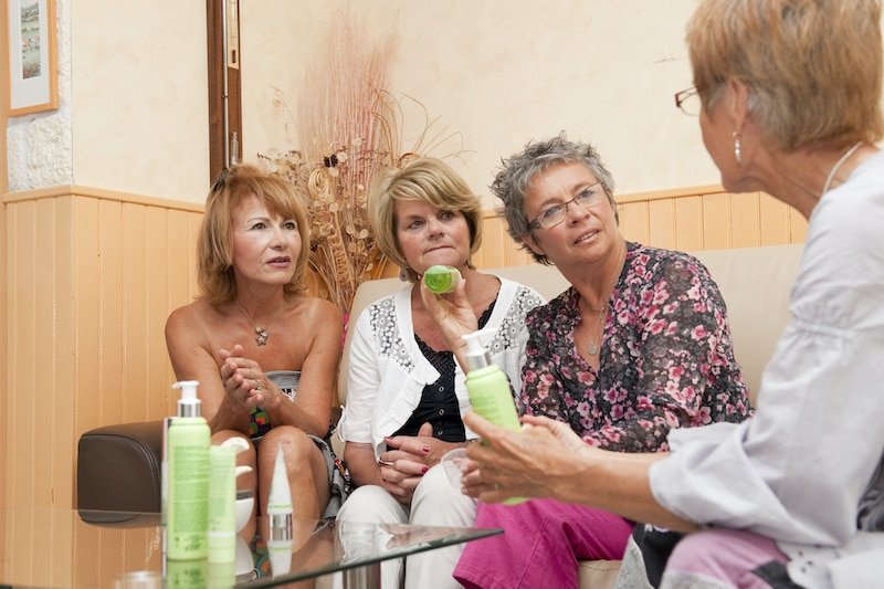 Group of women at a network marketing direct sales home party.