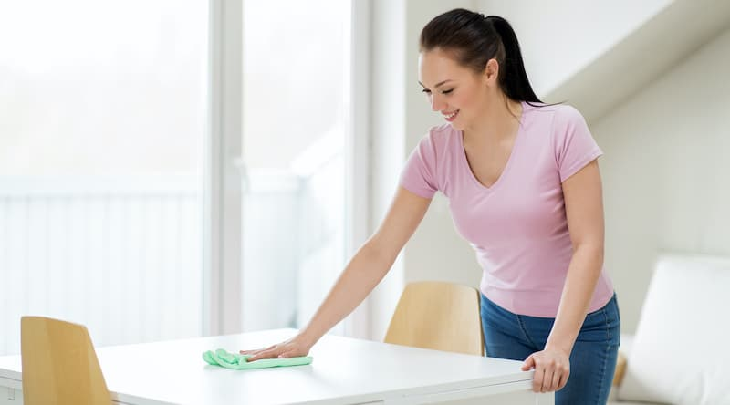 Lady Cleaning Table With Norwex Cloth