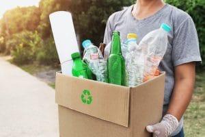Woman holding Box of plastic bottles