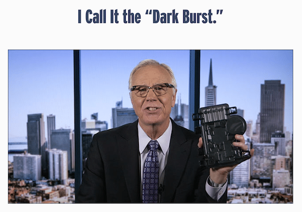 Dark Burst Device being held by Michael Robinson during an interview
