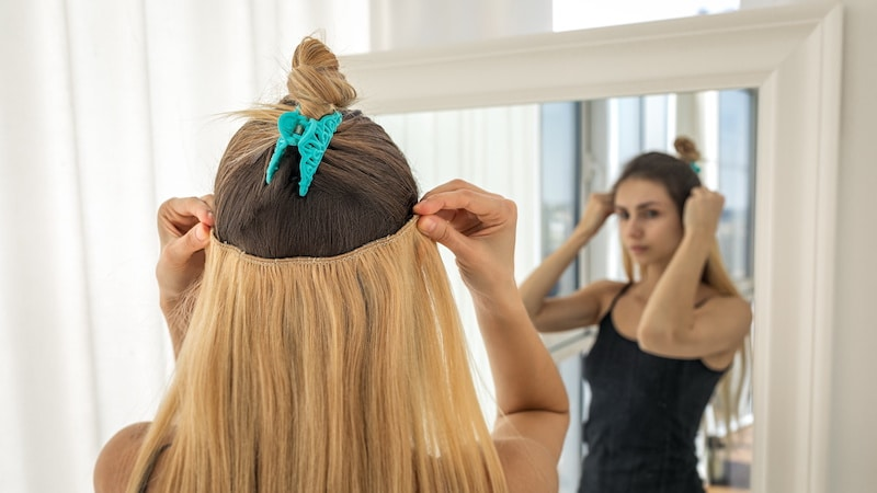 Instant hair extensions on hairpins for volume and elongation. Light blonde strands
