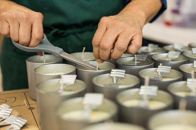 Closeup of person making homemade candles to sell