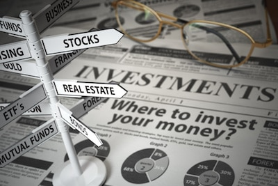 Investments and asset allocation concept with newspaper and direction sign with investment options in background.