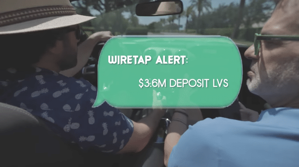 Lance Ippolito and Rob Booker in a car during the Weekend Wiretap presentation.
